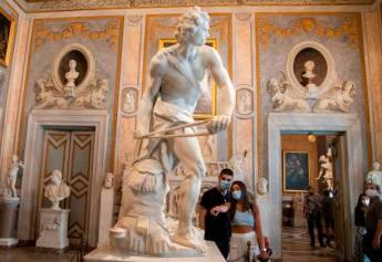"Visitors wearing a face mask view ""David"", a 1623-1624 marble sculpture by Gian Lorenzo Bernini at the Galleria Borghese museum in Rome on May 19, 2020, as it reopens while the country's lockdown is easing after over two months, aimed at curbing the spread of the COVID-19 infection, caused by the novel coronavirus. (Photo by Tiziana FABI / AFP) / RESTRICTED TO EDITORIAL USE - MANDATORY MENTION OF THE ARTIST UPON PUBLICATION - TO ILLUSTRATE THE EVENT AS SPECIFIED IN THE CAPTION (Photo by TIZIANA FABI/AFP via Getty Images)"