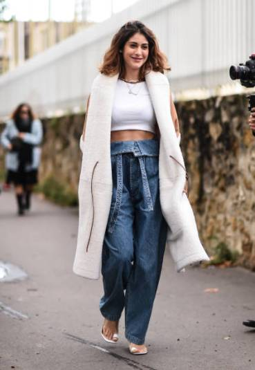 PARIS, FRANCE - SEPTEMBER 27: A guest is seen wearing a Loewe coat and jeans with a white top outside the Loewe show during Paris Fashion Week SS20 on September 27, 2019 in Paris, France. (Photo by Daniel Zuchnik/Getty Images)