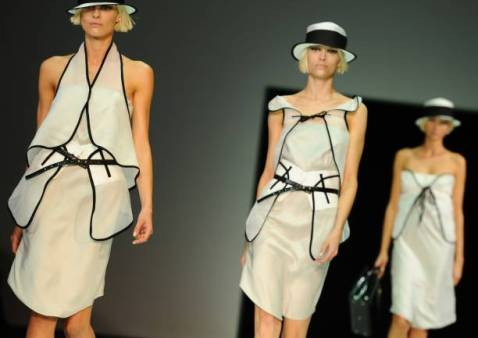Models display creations as part of Emporio Armani Spring-Summer 2012 ready-to-wear collection on September 24, 2011 during the Milan's women fashion week. AFP PHOTO / OLIVIER MORIN (Photo by Olivier MORIN / AFP) (Photo by OLIVIER MORIN/AFP via Getty Images)
