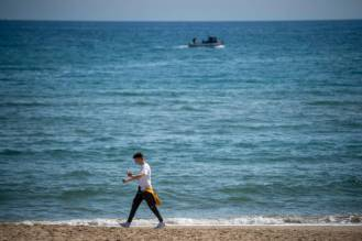 TERRACINA, ITALY - MAY 06: A boy wearing a protective mask walks on an empty beach about 100 km (80 miles) south of Rome during the third day of the so called phase two due to the Coronavirus (Covid-19) pandemic, on May 6, 2020 in Terracina, Italy. Italy was the first country to impose a nationwide lockdown to stem the transmission of the Coronavirus (Covid-19), and its restaurants, theaters and many other businesses remain closed. (Photo by Antonio Masiello/Getty Images)