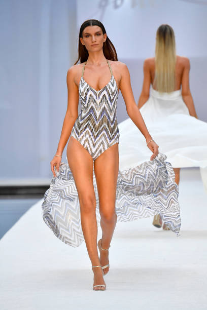 MIAMI BEACH, FL - JULY 22: A model walks the runway at SWIMMIAMI Gottex Cruise 2018 Fashion Show at WET Deck at W South Beach on July 22, 2017 in Miami Beach, Florida. (Photo by Frazer Harrison/Getty Images for Gottex)