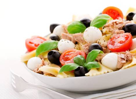 """Fresh salad with pasta, cherry tomatoes, black olives, tuna and basil"""