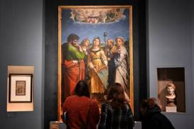 "Visitors look at the painting ""The Ecstasy of St Cecilia"" by Renaissance master Raffaello Sanzio da Urbino, known as Raphael, on March 4, 2020, displayed at the exhibition ""Raffaello"" at the Scuderie del Quirinale in Rome. - The exhibition, marking 500 years since the death of the Italian master, runs from March 5 to June 2, 2020. (Photo by Alberto PIZZOLI / AFP) (Photo by ALBERTO PIZZOLI/AFP via Getty Images)"