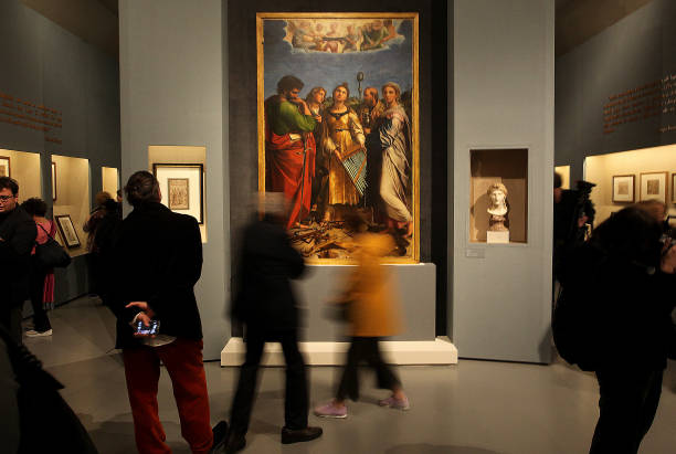 ROME, ITALY - MARCH 04,2020:A visitors look at the painting The Ecstasy of St Cecilia by Renaissance master Raffaello Sanzio da Urbino, known as Raphael, displayed at the exhibition Raffaello at the Scuderie del Quirinale in Rome. The exhibition, marking 500 years since the death of the Italian master, runs from March 5 to June 2, 2020- PHOTOGRAPH BY Marco Ravagli / Barcroft Studios / Future Publishing (Photo credit should read Marco Ravagli/Barcroft Media via Getty Images)