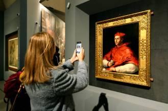 """ROME, ITALY - MARCH 04: Visitors admires the work """"Portrait of Cardinal Bibbiena"""" of Raffaello Sanzio (Raphael) during the preview of the """"Raffaello"""" exhibition about italian artist of Rinascimento (Renaissance) Raffaello Sanzio (Raphael)at Scuderie del Quirinale on March 04, 2020 in Rome, Italy. (Photo by Roberto Serra - Iguana Press/Getty Images)"""