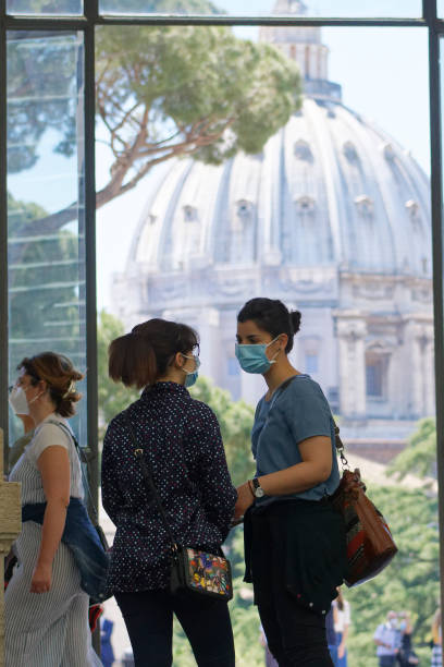 (EDITORIAL NEWS USE ONLY STRICTLY NO COMMERCIAL OR MERCHANDISING USAGE) People talks in the terrace during the Vatican Museum reopened, in Rome, Monday, June 1, 2020. The Vatican Museums reopened Monday to visitors after three months of shutdown following COVID-19 containment measures. (Photo by Massimo Valicchia/NurPhoto via Getty Images)