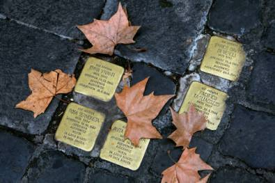 ROME, ITALY – DECEMBER 11: Small bronze plaques in memory of victims of the Holocaust are seen between the paving stones of the Jewish Ghetto on December 11, 2017, in Rome, Italy. The Roman Jewish Ghetto was originally established by Pope Paul IV in July 1555 as a walled quarter with its gates locked at night and survived until the walls were torn down in September 1870 when it the neighborhood remained the heart of the city's Jewish community. In October 1943 the Holocaust reached Rome when German Nazi troops entered the area and deported over 2,000 Jews, of which only about 100 survived the war. The quarter today is a bustling neighborhood famous for its ethnic Jewish food and restaurants. (Photo by David Silverman/Getty Images)