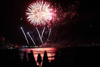 GROSSETO, ITALY - AUGUST 15: Fireworks light up the sky above the beach of Follonica and Punta Ala celebrating the 'Ferragosto' on August 15, 2013 in Grosseto, Italy. The term Ferragosto is derived from the Latin expression Feriae Augusti (Augustus' rest), which is a celebration introduced by the emperor Augustus. (Photo by Franco Origlia/Getty Images)
