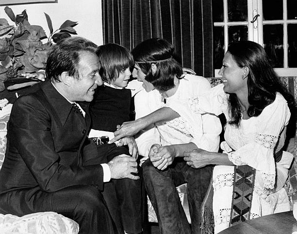 Italian actor and director Ugo Tognazzi (Ottavio Ugo Tognazzi) sitting on a sofa and smiling with his wife Italian actress Franca Bettoja and his sons Gianmarco and Ricky Tognazzi (Riccardo Tognazzi). Velletri, 1972 (Photo by Rino PetrosinoMondadori Portfolio by Getty Images)