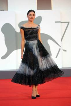 """VENICE, ITALY - SEPTEMBER 03: Natasha Andrews walks the red carpet ahead of the movie """"Amants"""" at the 77th Venice Film Festival at on September 03, 2020 in Venice, Italy. (Photo by Elisabetta A. Villa/WireImage,)"""