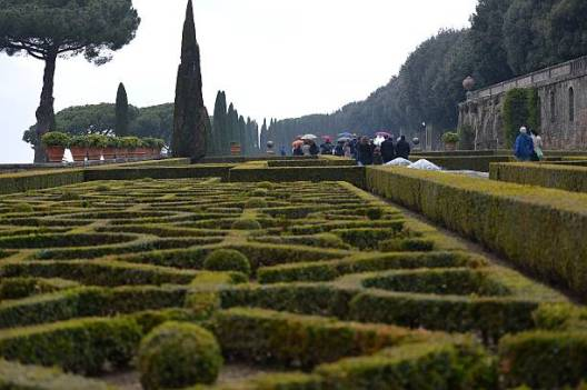 """People visit the gardens of pope's summer residence of Castel Gandolfo, south of Rome, on March 22, 2014 in Castel Gandolfo. From March 1st, the gardens surrounding the papal summer residence are open to the public. Located south of Rome in the Alban hills, the property includes the extensive Barberini gardens, the remains of a Roman villa and a 62 acre farm, as well as the ancient papal palace. A statement from the director of the Vatican Museums says it was Pope Francis himself who decided to make accessible to all the gardens of the Pontifical Villas. A guided tour of the gardens, in Italian or English, will be available to individuals or groups through an online booking system. AFP PHOTO / VINCENZO PINTO = RESTRICTED TO EDITORIAL USE - MANDATORY CREDIT """"AFP PHOTO/VINCENZO PINTO"""" - NO MARKETING NO ADVERTISING CAMPAIGNS - DISTRIBUTED AS A SERVICE TO CLIENTS = (Photo credit should read VINCENZO PINTO/AFP via Getty Images)"""