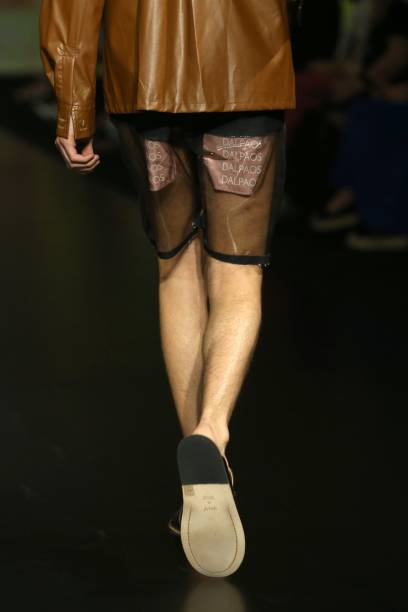 """ROME, ITALY - JULY 08: A model walks the runeway at the Altaroma 2021 - Dalpaos """"Palindrome"""" at Cinecitta Studios on July 08, 2021 in Rome, Italy. (Photo by Elisabetta Villa/Getty Images)"""
