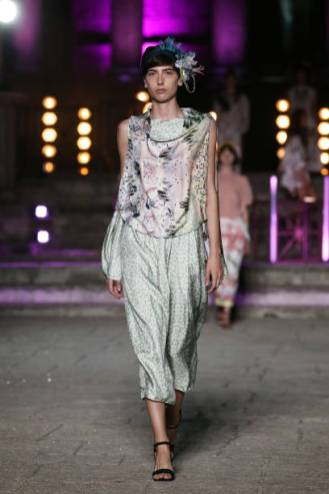 ROME, ITALY - JULY 10: A model walks the runway wearing a Valeria Vezzani dress at the Rome Is My Runway #2 fashion show during Altaroma 2021 at Cinecitta Studios on July 10, 2021 in Rome, Italy. (Photo by Elisabetta Villa/Getty Images)
