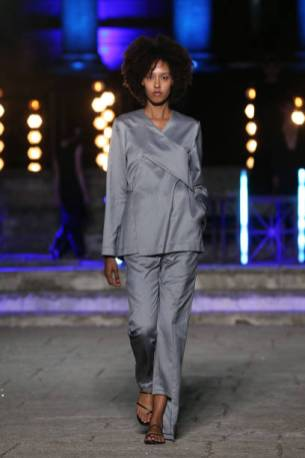ROME, ITALY - JULY 10: A model walks the runway wearing a Feelomena dress at the Rome Is My Runway #2 fashion show during Altaroma 2021 at Cinecitta Studios on July 10, 2021 in Rome, Italy. (Photo by Elisabetta Villa/Getty Images)