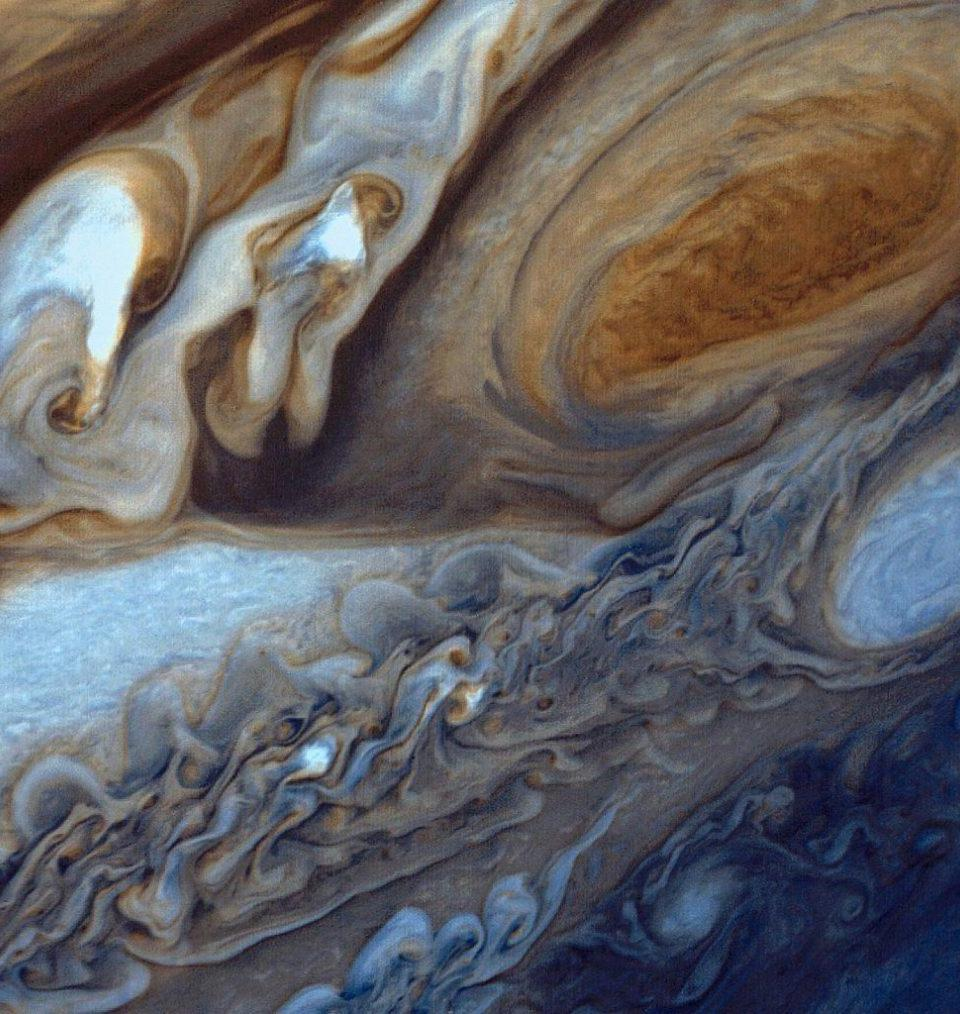 A false-color image of the Great Red Spot of Jupiter from Voyager 1. The white oval storm directly below the Great Red Spot, a temporary storm that has since dissipated, has approximately the same diameter as the Earth.