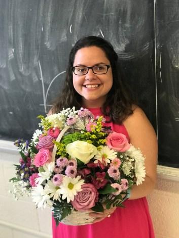 Woman holding a flower bouquet