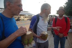 Drinking some coconut water at the Togo border. From left to right, Claude Levesque, Michel Waldschmidt, and Jorge Jimenez Urroz.