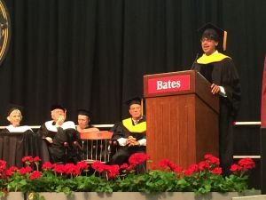 Manjul Bhargava delivering his commencement address. Behind him are the other honorands. Left to right in the front row: Joan Benoit Samuelson, Thomas Moser, and Mark Abelson.