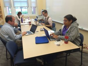 The Hood new faculty writing group pretends to act naturally while being photographed