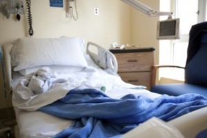 Empty-hospital-bed-scale-300x200
