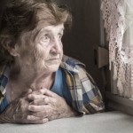 elderly woman looking out