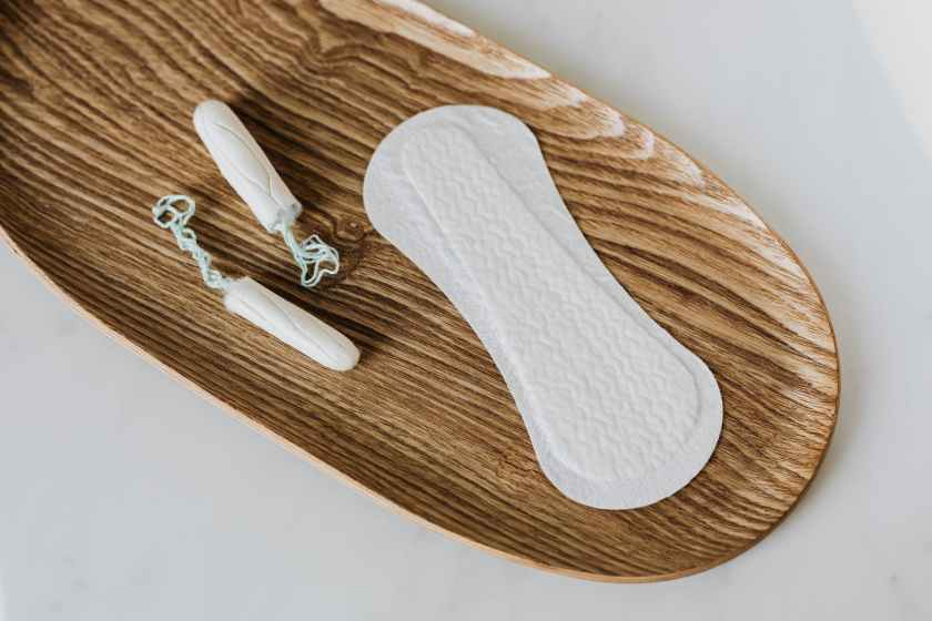 products of personal hygiene for women on wooden stand