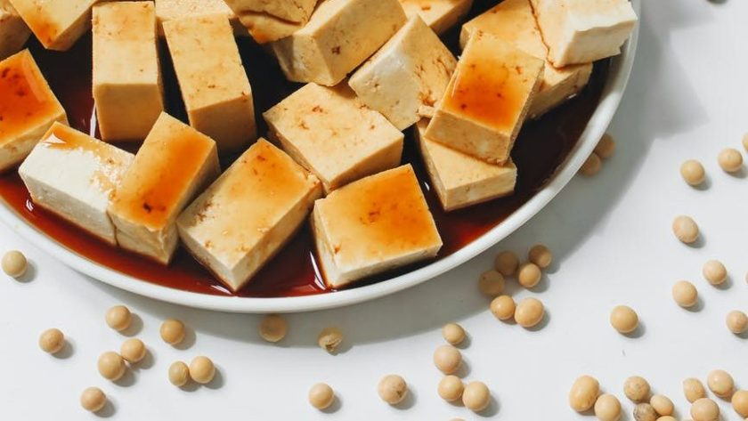 sliced tofu with soy sauce on white ceramic plate