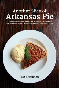 """Cover of Kat Robinson's book, """"Another Slice of Arkansas Pie"""" featuring a plate of pecan pie and a scoop of vanilla ice cream"""