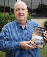 Picture of Jim Yeager, holding his book