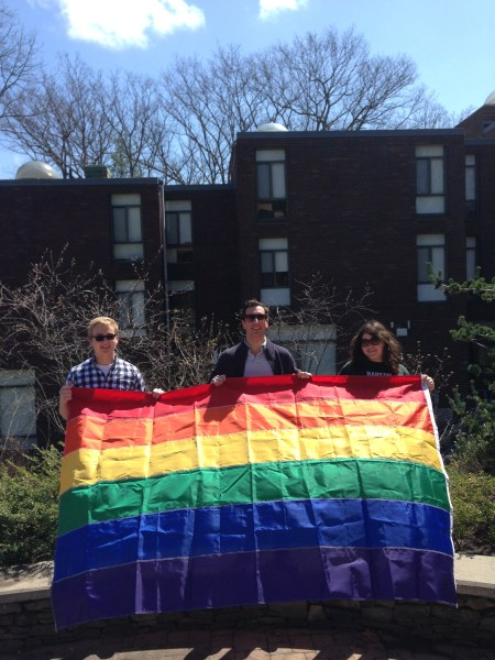Matt Hard and other members of the Pride Alliance in front of the Pride Tower