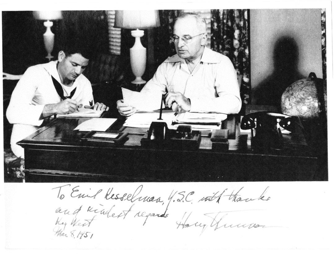 Alumnus Emil Kesselman sits next to President Harry Truman