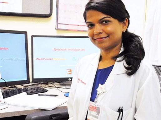 Alumna Anisha Rathod at her desk