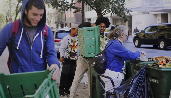 Tim Hartney, left, Kevin Doby and Nadine Wolff dispose of organic waste from Greenmarket farmers at a GrowNYC drop-off on the Upper East Side.