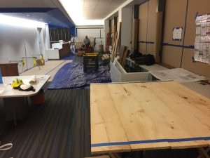 Carpentry Work in New Aisle Toward Desk