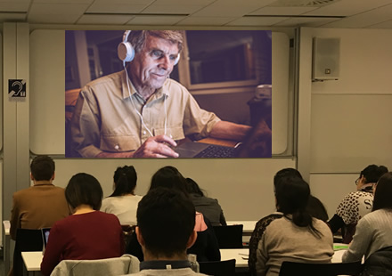 Students interacting with expert patient on Skype. Photo of actual session and students, but the image of the expert patient has been replaced with a stock image @istock