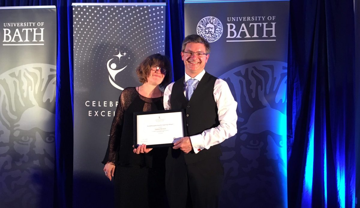 Simon Brown holding his certificate