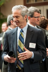 Image of Dr. Jason Rogers greeting people at an event.