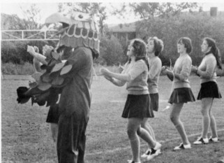 Bentley cheerleaders and the Falcon (not yet known as Flex) during the first Homecoming football game, 1975.
