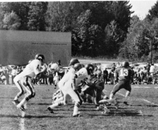 Football game during the first Homecoming Weekend, 1975.