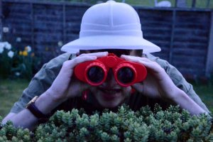 Explorer with binoculars.