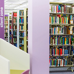 Rows of bookshelves in the University library.