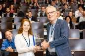 Laura Braun accepts the Professor Huw Taylor award