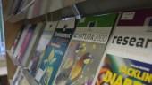 EU publications on a display shelf.