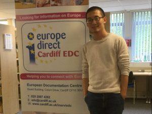 Zhang Jianhui (Carson) standing next to the Cardiff EDC banner.