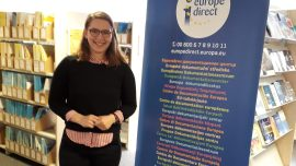 Emma Consenheim standing next to a Europe Direct banner.