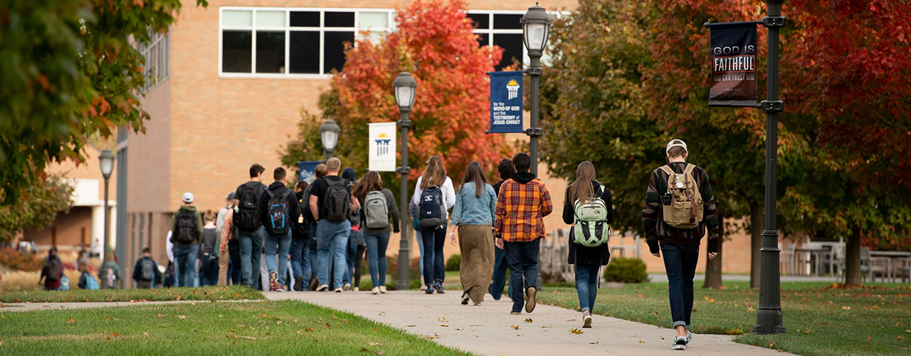 Students on sidewalk in fall