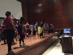 students on the DMC Recital Hall Stage learning African expressions