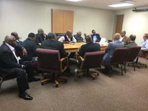 room full of pastors seated around a conference table