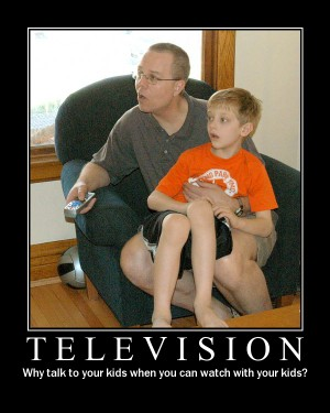 Fake demotivational poster of a man watching TV with his kids.  Very funny and would make a good demotivational wallpaper