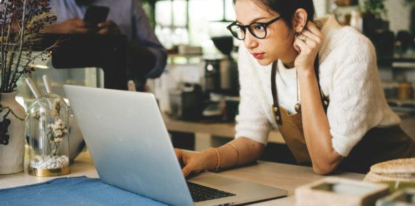 Business owner viewing customer feedback